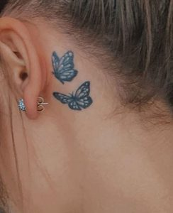 Blue Tattoo Behind Ear